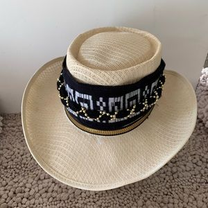 Hat with decorative band